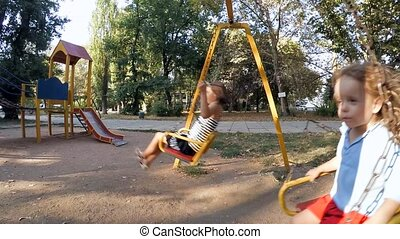 Children ride on a swing at the site