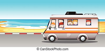 Children riding in camper van to the beach