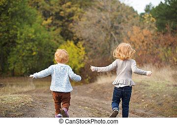 Children run down the hill - Red children run down the hill