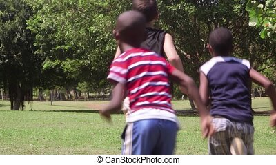 Children running and playing, group