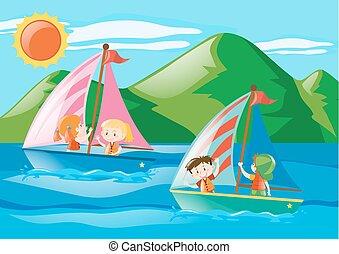 Children sailing boats in the sea
