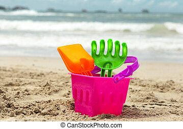 Children sand toys on the beach