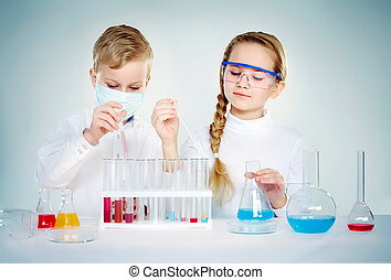 Children scientists - Two children making chemical ...