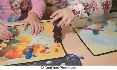 Children sculpting figures from plasticine - Children...