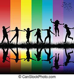 Children silhouettes over rainbow background