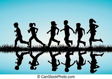 Children silhouettes running outdoor