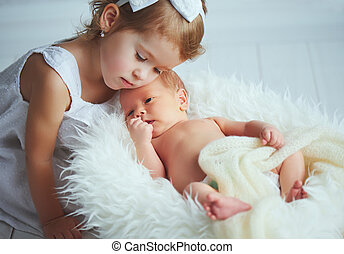 children sister and brother newborn baby on a light