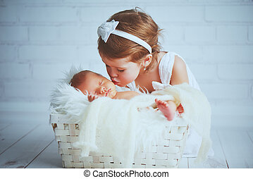 children sister kisses brother newborn sleepy baby on a light background