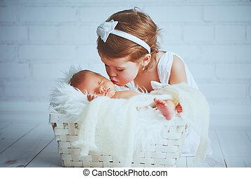 children sister kisses brother newborn sleepy baby on a light