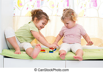 children sisters play together indoors