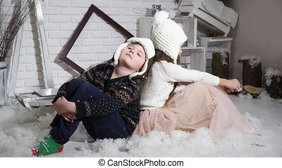 Children sit with his back