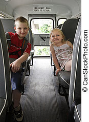 Children sitting in a school bus