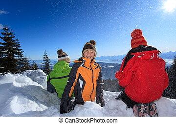 Children Sitting in Snow
