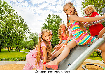 Children sitting on playground construction