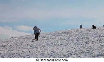 Children sledding in winter