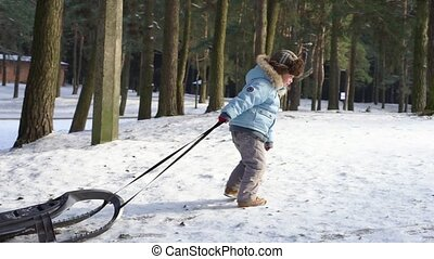 Children sledding on snow. Active fun for family Christmas vacation