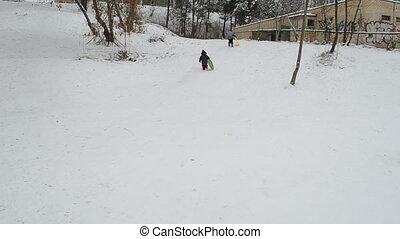 children snow slide play