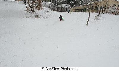 children snow slide play