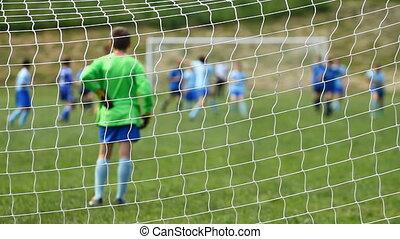 Children soccer from behind net