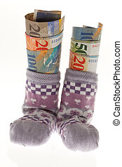 Children socks with Swiss franc banknotes
