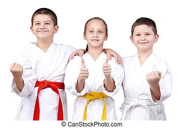Children stand in rack of karate