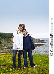 Children standing at Atlantic coast in Newfoundland