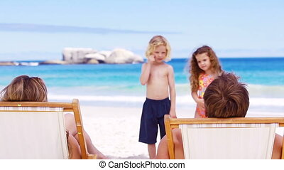 Children standing in front of their parents