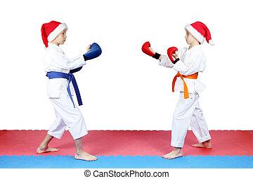 Children standing in rack of karate