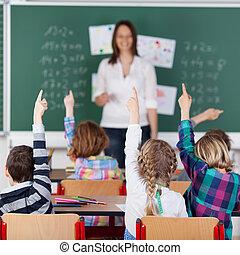 Children - Portrait of children raised their hands in the...