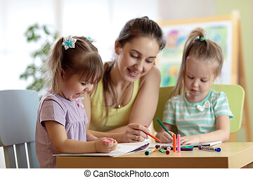 Children students with teacher drawing in art school class. Mother and kids at home. Children indulge.