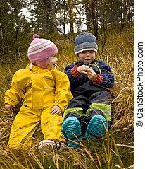 Children talking together in an autumn forest
