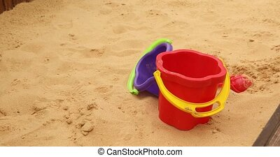 Children toys buckets, spade and shovel on sand outdoors