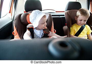 Children traveling in car