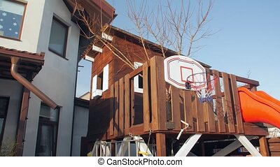 Children treehouse in yard camera movement