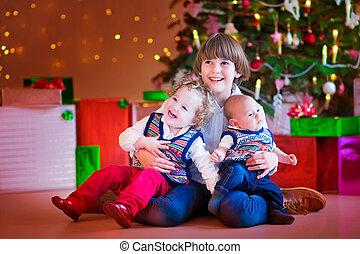 Children under a Christmas tree