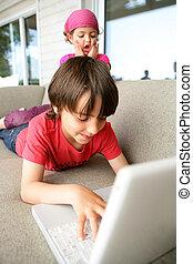 Children using a laptop computer