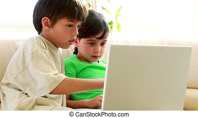 Children using a laptop together