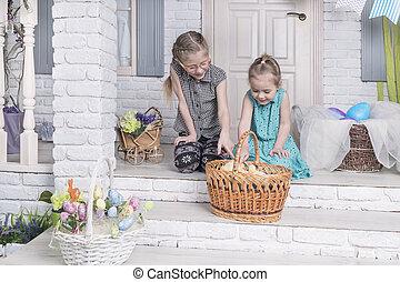 children view chickens in a basket