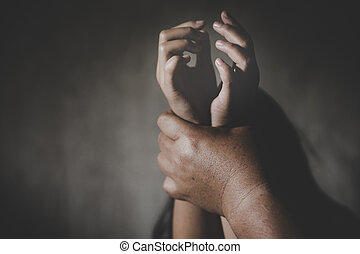 Children violence. Man's hand holding tight girl's hands