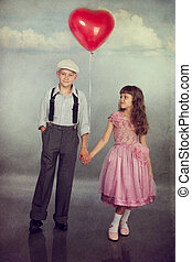 Children walk with a balloon