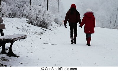 Children walking in snow