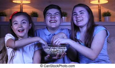Children watching a comedy film