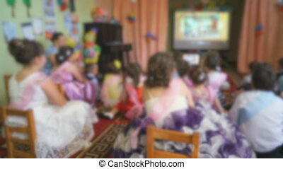 Children watching the pictures using a projector at the...