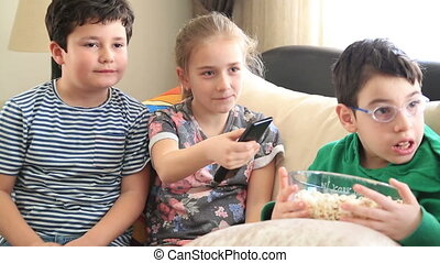 Children watching tv and laughing