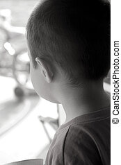 Children-Wishing to go Outside - Little boy looking out the...