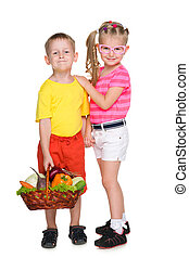 Children with a basket of vegetables