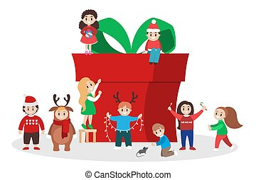 Children with a big gift box. Group of people prepare christmas