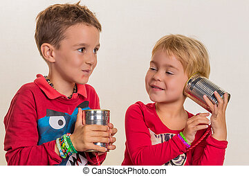 children with a dosentelefon - two little children with a ...