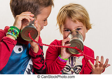 children with a dosentelefon - two little kids calling with ...