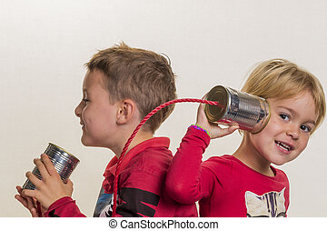 children with a dosentelefon - two small children call to a ...